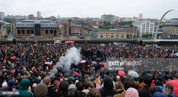 People gather to listen to Labour Leader Jeremy Corbyn as he delivers a speech at a rally next to the Sage building on June 5 2017 in Gateshead...