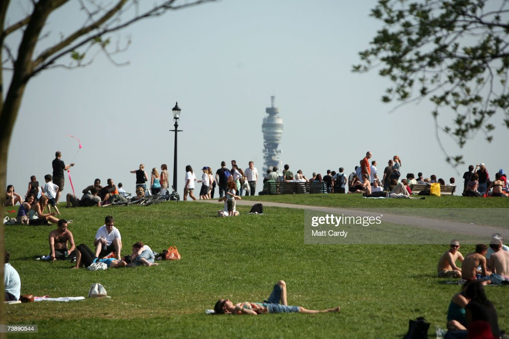 People gather to look at the view as they enjoy the hot weather in Primrose Hill on April 15, 2007 in London. The un-seasonably warm weather has heralded the start to what weather forecasters predict will be a record breaking summer.