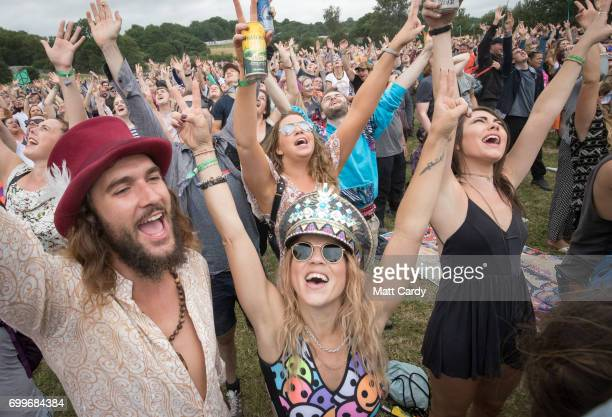 People gather to make a giant human peace sign at the Stone Circle at the Glastonbury Festival at Worthy Farm in Pilton on June 22 2017 near...