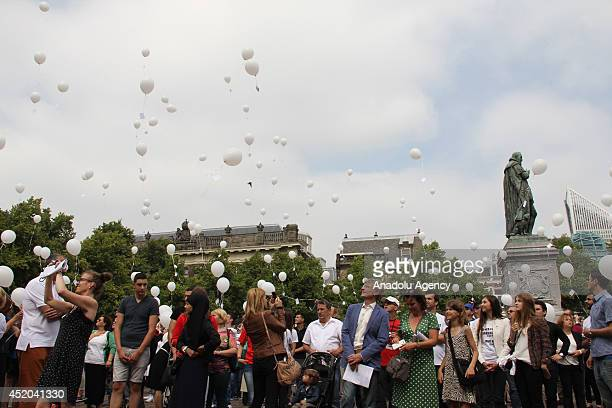 People gather to mark 19th anniversary of Srebrenica massacre in the Hague Netherlands on July 11 2014