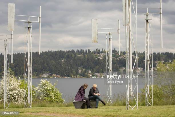 People gather to mourn at A Sound Garden the sculpture that inspired the name of the band Soundgarden on May 18 2017 in Seattle Washington Musician...