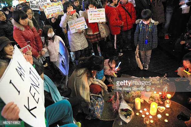 People gather to mourn slain two Japanese hostages by Islamic State militant group Haruna Yukawa and Kenji Goto on February 8 2015 in Tokyo Japan