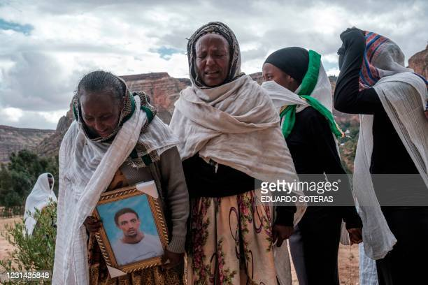 People gather to mourn the victims of a massacre allegedly perpetrated by Eritrean Soldiers in the village of Dengolat, North of Mekele, the capital...