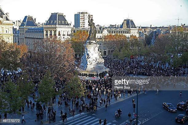 People gather to mourn the victims of the terrorist attacks at the Place de La Republique square on November 15 2015 in Paris France As France...