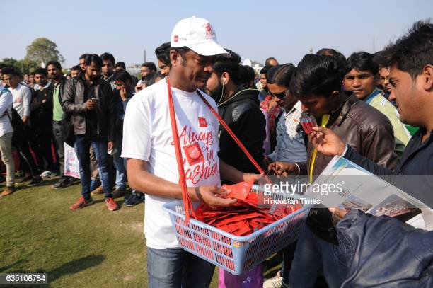People gather to observe the International Condom Day at an event organised by Aids Healthcare Foundation on February 13 2017 in New Delhi India 13th...