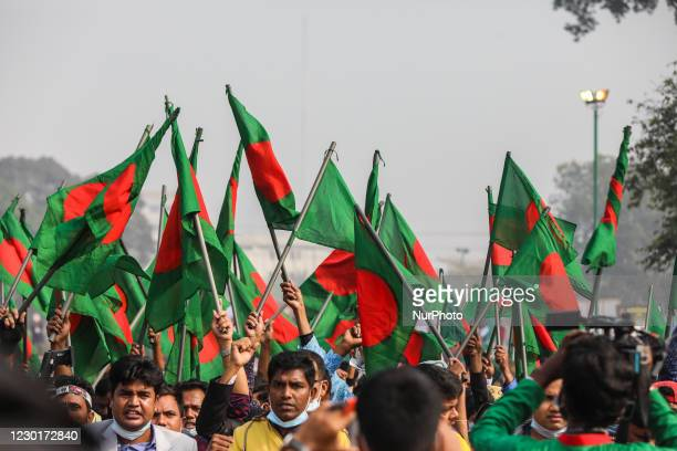 People gather to pay their respect at the national memorial of the 1971 Bangladesh independence war's martyrs to mark the country's Victory Day in...