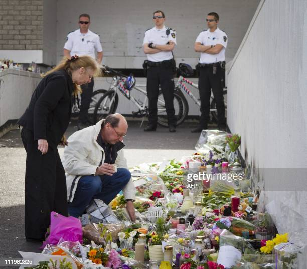 People gather to pay their respects to the victims of the shooting spree at the shopping mall De Ridderhof in Alphen aan den Rijn, on April 11, 2011...