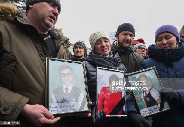 TOPSHOT People gather to pay tribute to the victims of a fire at a shopping centre in Kemerovo on March 27 2018 Russian authorities on on March 26...