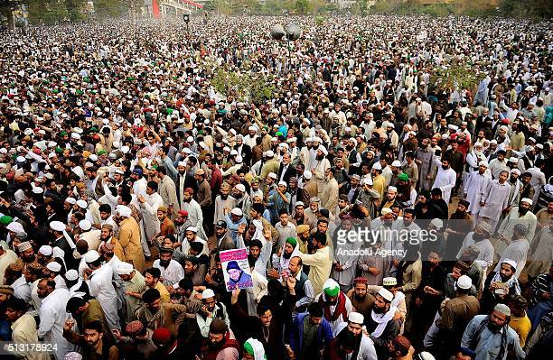 People gather to perform funeral prayers during a funeral ceremony held for Mumtaz Qadri former police bodyguard who shot dead Punjab's governor...