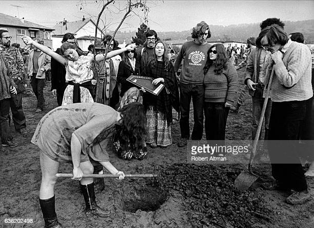 People gather to plant trees flowers shrubs and sod in People's Park circa April 1969 in Berkeley California