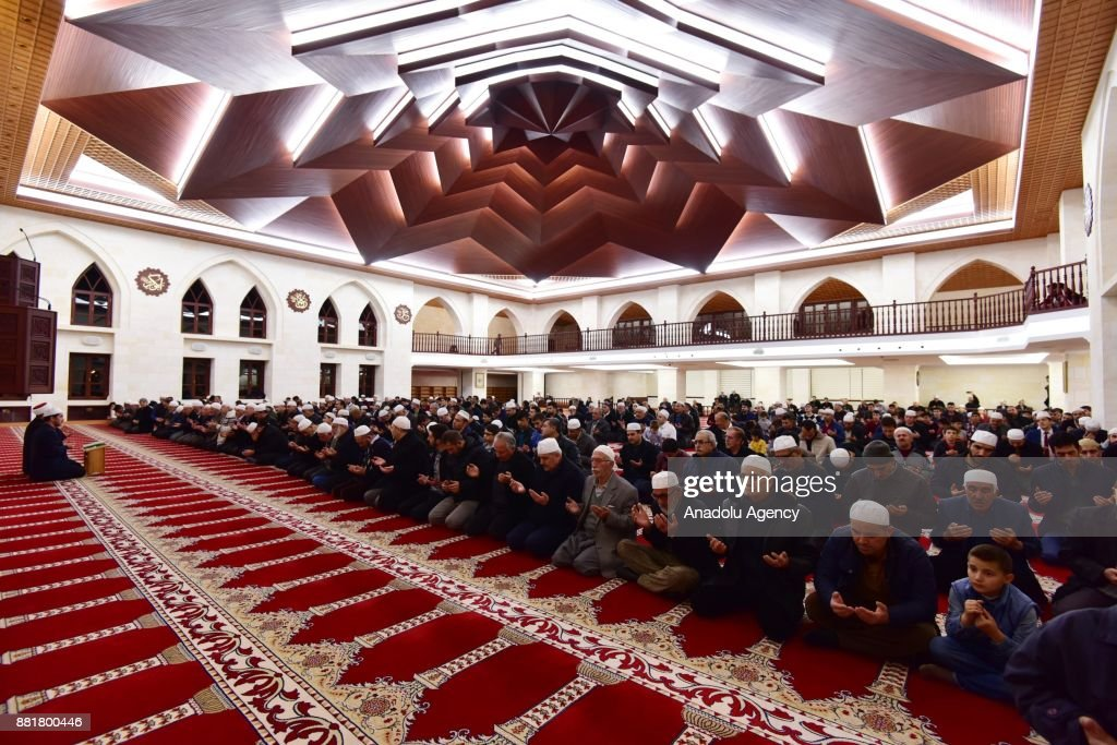 People gather to pray at the Somuncu Baba Mosque during a religious ceremony within the celebrations for Mawlid al-Nabi, the birth anniversary of Muslims' beloved Prophet Mohammad, in Darende district of Malatya, Turkey on November 29, 2017.