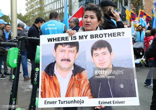 People gather to protest against China's Uyghur policy in Brussels Belgium on October 1 2019