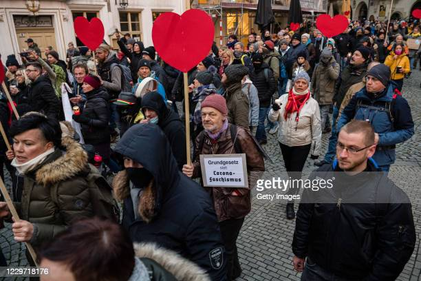 People gather to protest against coronavirus lockdown measures during the second wave of the pandemic on November 21, 2020 in Leipzig, Germany. The...