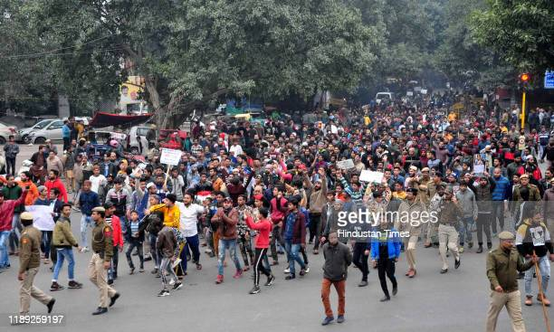 People gather to protest against the Citizenship Amendment Act near Jama Masjid area on December 17 2019 in New Delhi India