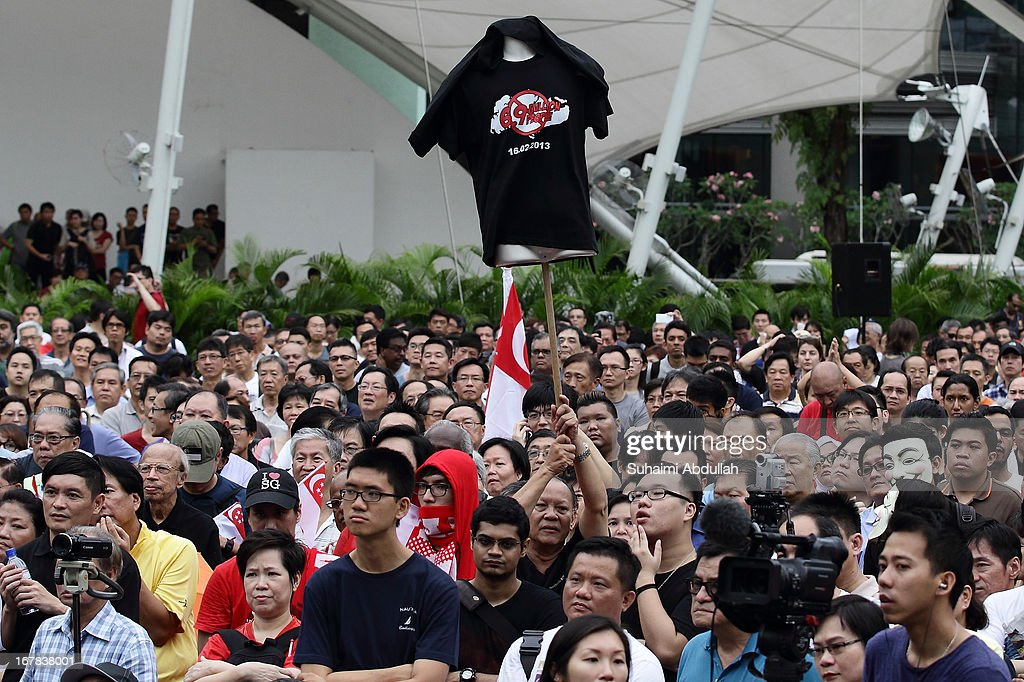 People gather to protest against the government's White Paper on Population and labour-related matters that affect Singaporeans at Speakers' Corner in Hong Lim Park on May 1, 2013 in Singapore. Thousands of protesters gathered today in an inaugural labour day protest against the 6.9 million population government white paper that revealed it could increase 30% to 6.9 million by 2030, angering residents who already see a strain on housing, transportation and healthcare. This is a follow up protest after one was held on 16 Feb, 2013 organised by the same organiser, transitioning.org