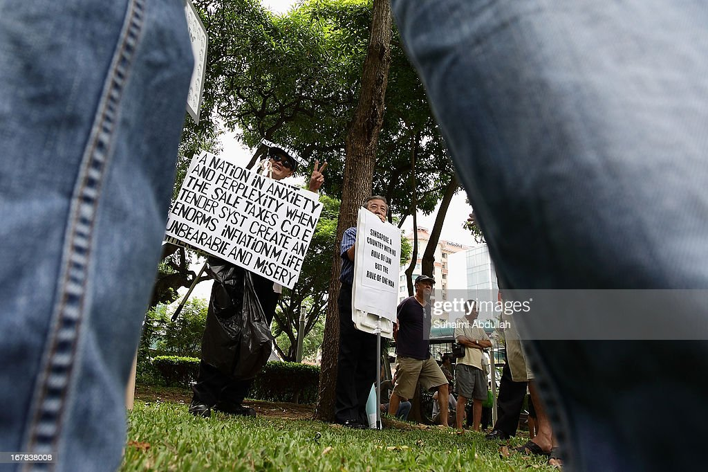 People gather to protest against the government's White Paper on Population and labour-related matters that affect Singaporeans at Speakers' Corner in Hong Lim Park on May 1, 2013 in Singapore.Thousands of protesters gathered today in an inaugural labour day protest against the 6.9 million population government white paper that revealed it could increase 30% to 6.9 million by 2030, angering residents who already see a strain on housing, transportation and healthcare. This is a follow up protest after one was held on 16 Feb, 2013 organised by the same organiser, transitioning.org