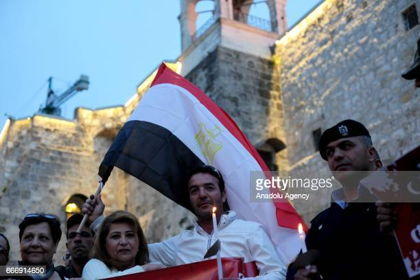 People gather to protest against two church bombings in Egypt that killed at least 43 people and injured scores in Bethlehem West Bank April 10 2017