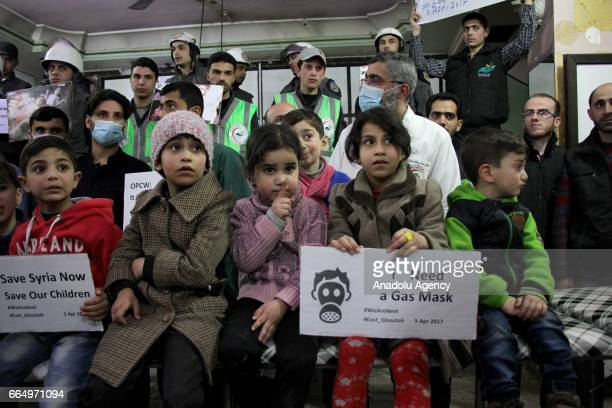 People gather to protest Assad regime forces' suspected chemical gas attack in the oppositionheld Syrian province of Idlib in Eastern Goutha district...