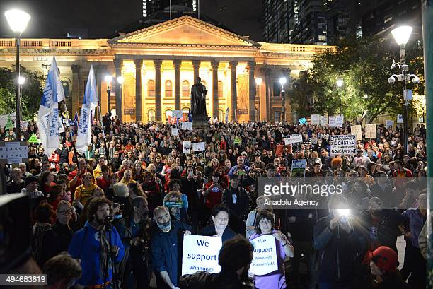 People gather to protest Australia Federal Government's new regulation about health spending in Melbourne Australia on 30 May 2014 People protest...