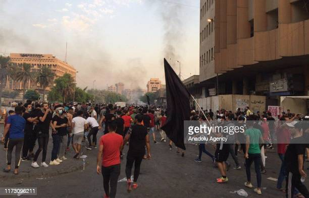 People gather to protest government due to corruption unsolved unemployment issue and inadequate public service in Baghdad Iraq on October 02 2019