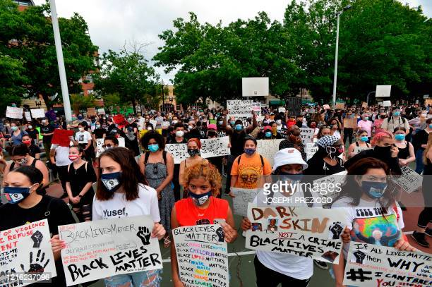 People gather to protest in outrage after George Floyd an unarmed black man died while being arrested by a police officer in Minneapolis who pinned...