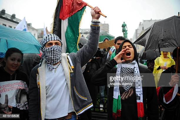 People gather to protest Israeli air strikes on Gaza at the Place du Luxembourg in Brussels Belgium on July 9 2014 They shout slogans and hold...