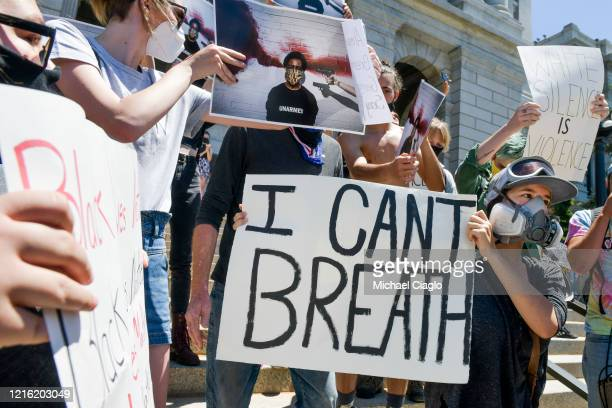 People gather to protest the death of George Floyd on the steps of the Colorado state capitol on May 29 2020 in Denver Colorado Yesterday protests in...