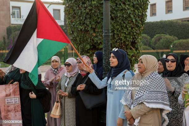 People gather to protest the raids of Jews in Masjid alAqsa in occupied Eastern Jerusalem in front of the Parliamentary building in Rabat Morocco on...