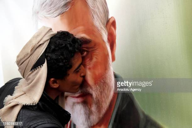People gather to protest the US air strike in Iraq that killed Iranian commander Qasem Soleimani who headed Iran's Revolutionary Guards' elite Quds...