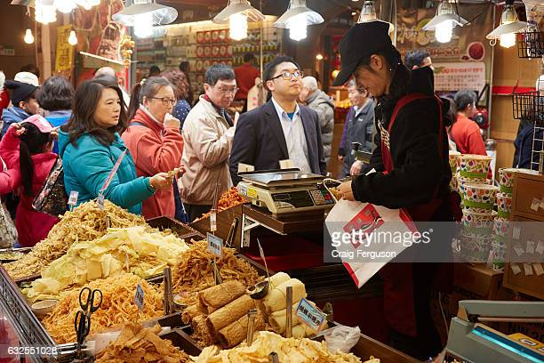 People gather to purchase dried fish and squid at the Chinese New Year market For the two weeks leading up to the lunar new year holiday a special...