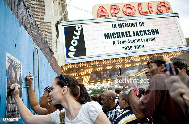 People gather to remember Michael Jackson at the Apollo Theater on June 26 2009 in New York City Jackson the iconic pop star died after going into...