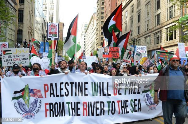 People gather to stage a demonstration in support of Palestinians and to protest against Israeli attacks on Gaza Strip in Chicago, Illinois, United...