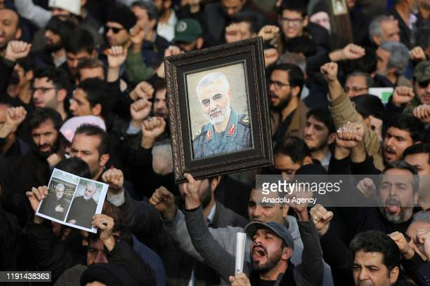 People gather to stage a protest against the killing of Iranian Revolutionary Guards' Quds Force commander Qasem Soleimani by a US air strike in the...