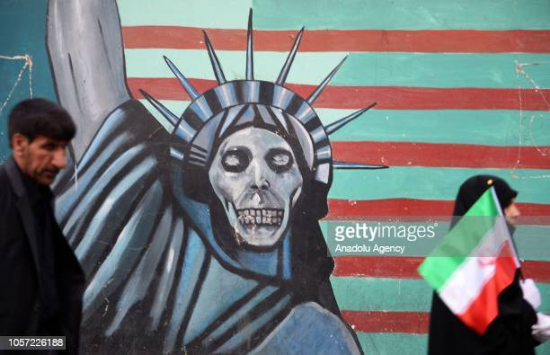 People gather to stage a protest against United States due to the 39th anniversary of the occupation of former US Embassy building in Tehran, Iran on...
