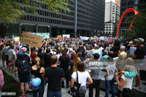 People gather to stage a protest in response to violence erupting at the rally in Charlottesville at Federal Plaza Square in Chicago United States on...