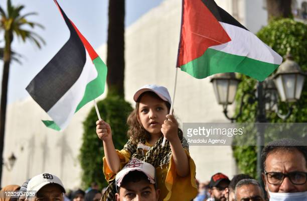 People gather to stage a protest in solidarity with Palestinians exposed to Israel's attacks in Jerusalem and Gaza, in Rabat, Morocco on May 16,...