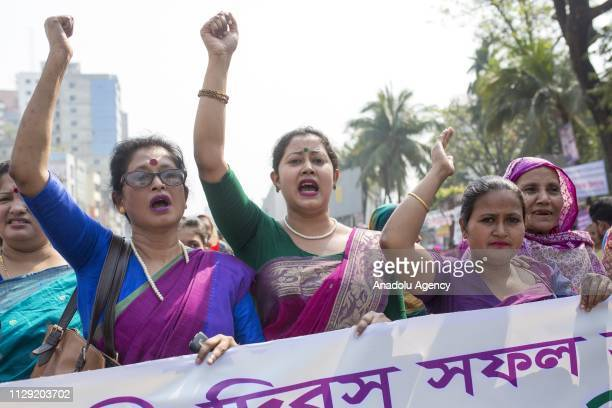 People gather to stage a protest to mark the International Women's Day outside National Press Club in Dhaka , Bangladesh on March 08, 2019. Several...