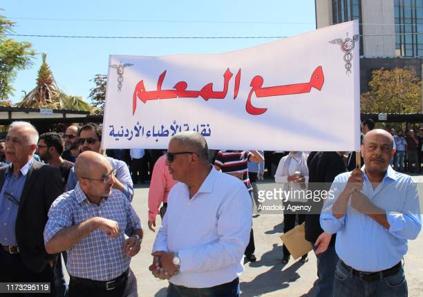 People gather to stage a rally in support of teachers who launched nationwide strike demanding salary hike, in Amman, Jordan on October 03, 2019.