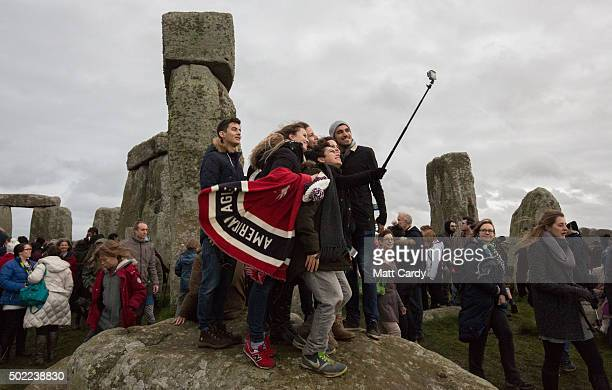 People gather to take a selfie photograph as pagans and revellers gather at Stonehenge hoping to see the sun rise as they take part in a winter...