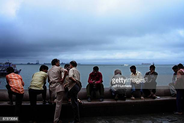 People gather to talk on September 09 2005 in Mumbai India Emerging from one of the most deadly monsoon seasons in recent history daily life gets...