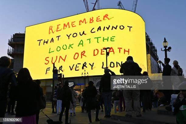 """People gather to view a new artwork from British artist David Hockney entitled """"Remember you cannot look at the sun or death for very long"""" is..."""