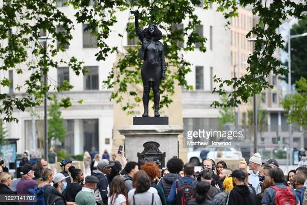 People gather to view a new sculpture, by local artist Marc Quinn, of Black Lives Matter protestor Jen Reid on the plinth where the Edward Colston...