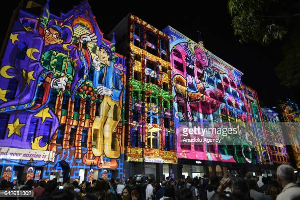People gather to watch 3D video mapping shows during White Night activites in Melbourne Australia on February 18 2017 Historical buildings such as...