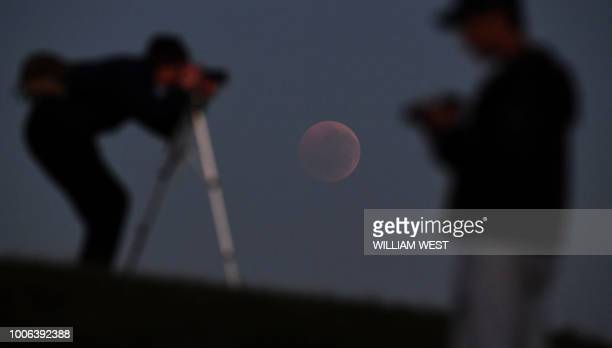 People gather to watch a blood moon eclipse in Melbourne on July 28 2018