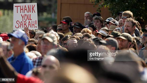 People gather to watch as Alaska Governor Sarah Palin officially resigns during the annual Governor's Picnic July 26 2009 at Pioneer Park in...