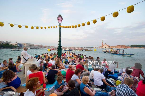 People gather to watch boats of all sizes at Punta della Dogana in St Mark's basin for the Redentore Celebrations on July 20 2013 in Venice Italy...