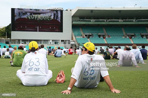 People gather to watch the funeral service held in Macksville for Australian cricketer Phillip Hughes at the Sydney Cricket Ground on December 3 2014...