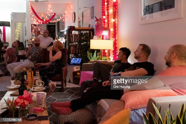 People gather to watch the Pink Dot SG rally livestream in a house on June 27 2020 in Singapore Due to the ongoing coronavirus pandemic this years...