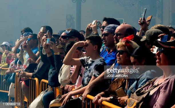 People gather to watch the traditional 'Mascleta' during the Fallas festival in Valencia on March 16 2019