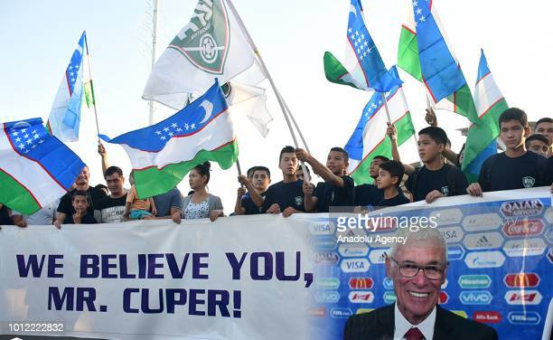 People gather to welcome head coach of Uzbekistan Hector Cuper as he arrives to attend the signing ceremony for the Uzbek National Football Team in...